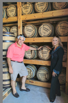 Catskill Distilling Company - Edward F. Nesta, Debra C. Argen in Barrel storage room - photo by Luxury Experience