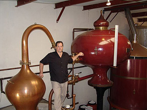 Marko Karakasevic with his pot stills at CHARBAY Winery & Distillery