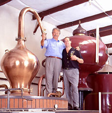 Miles and Marko Karakasevic atop pot still at CHARBAY Winery & Distillery