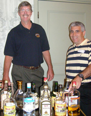 Ed Hamilton and Edward F. Nesta checking out Martinique Rhum in competition