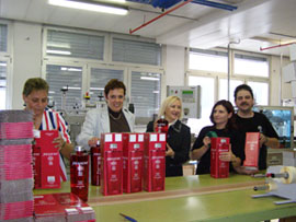 Swiss Vodka - Debra helps with packaging