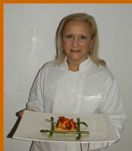 Debra C. Argen  with Shrimp Dish - photo by Luxury Experience