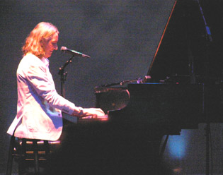 Roger Hodgson on piano - Photo by Luxury Experience