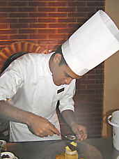 Aioli Restaurant Chef Saul Herrea finishing a dessert