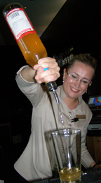 Jeanette mixing a drink at Aquavit Grill & Raw Gar, Stockholm, Sweden