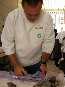 Chef Charlie Palmer sucking oysters  - Photo by Luxury Experience
