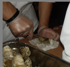 Shucking Oysters - Docks Oyster Bar and Seafood Grill - NY, NY, - photo by Luxury Experience