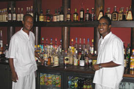 A well stocked bar at Cap Est Lagoon Resort & Spa