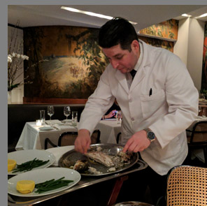 Rafael Filleting Bronzini tableside - The Leopard at des Artistes NYC - photo by Luxury Experience
