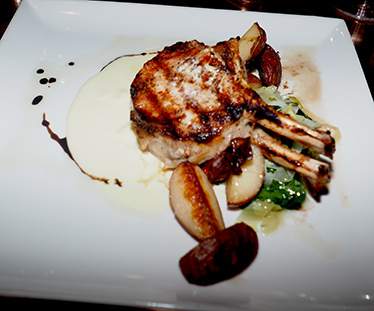 Grilled Pork Chop - Revival Kitchen and Bar - Concord, NH - photo by Luxury Experience