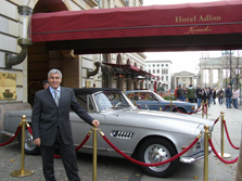 Edward F. Nesta in front of Hotel Adlon with Classic BMW's on display