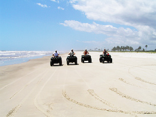 Debra, Ed, Regina and Gilberto riding ATVs