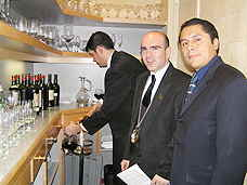 Serving th 1955 wine were Tryo Daigle, Michel Coureux, Edgar Aguilar